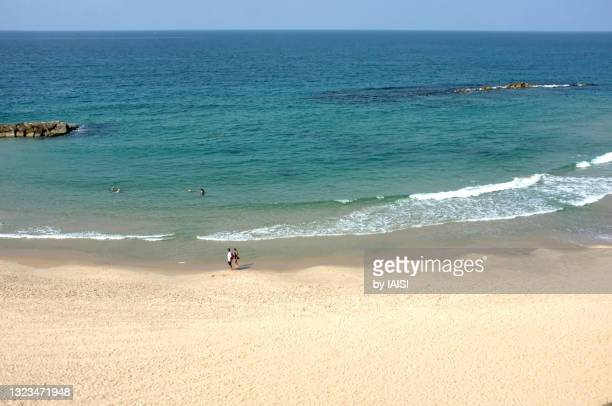a sandy beach and turquoise mediterranean sea, ashqelon the southern coastline - netanya stock pictures, royalty-free photos & images