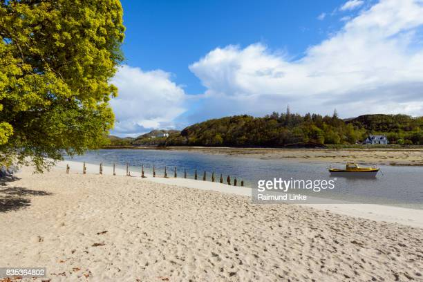 sandy beach at sea bay, mallaig, scotland, united kingdom - mallaig stock photos and pictures
