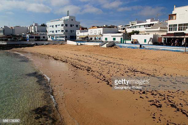 Sandy beach backed by bars and hotels in Corralejo Fuerteventura Canary Islands Spain