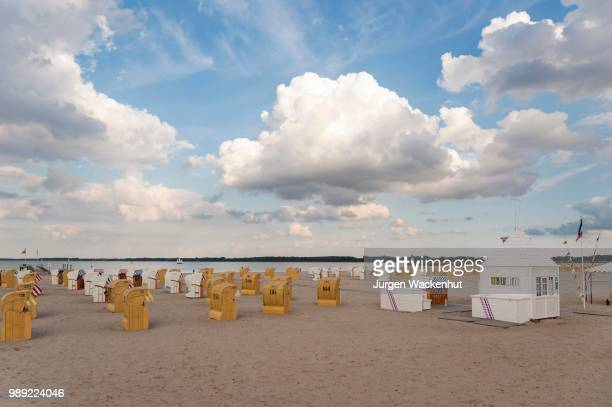 sandy beach beach with beach chairs, travemuende, baltic sea, schleswig-holstein, germany - schleswig holstein stock pictures, royalty-free photos & images