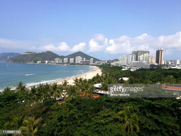 sandy beach hotels asia summer vacation sanya - hainan island stock pictures, royalty-free photos & images