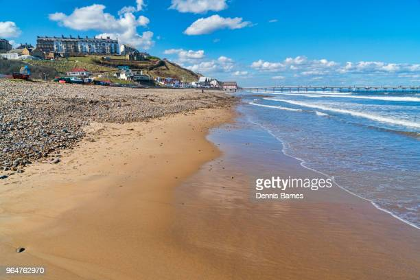 sandy beach, looking to saltburn-by-the-sea, beach, pier, cleveland, north yorkshire - saltburn stock photos and pictures