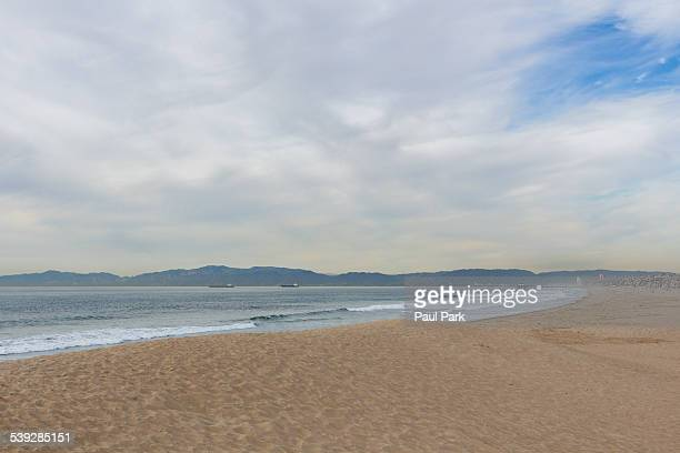sandy beach on an overcast day - hermosa beach stock pictures, royalty-free photos & images
