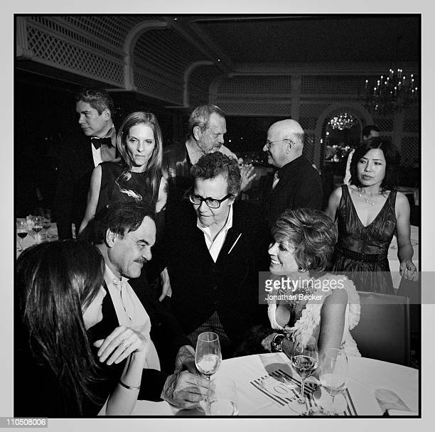 Sandy Brant, Terry Gilliam, Edward Pressman, Peggy Siegal, Ingrid Sischy and Oliver Stone are photographed at Vanity Fair Cannes Party at the Eden...