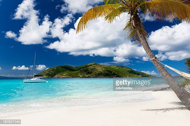 sandy cay - tropical island in the caribbean - catamaran stock photos and pictures