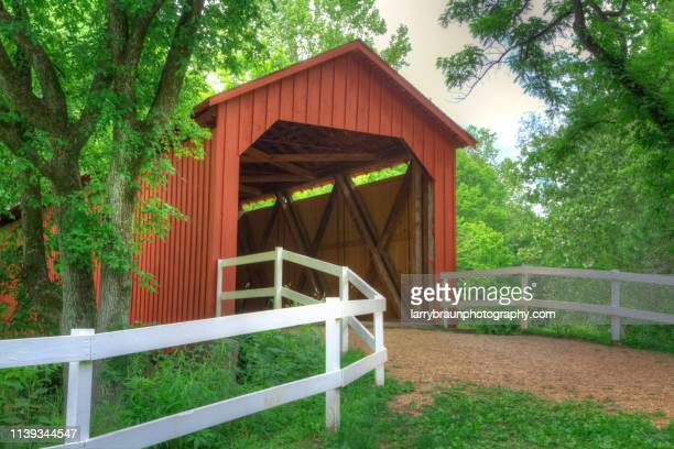 sandy creek covered bridge - covered bridge stock photos and pictures