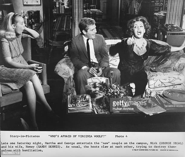 "Sandy Dennis and George Segal are entertained by Elizabeth Taylor in a scene from the Warner Bros movie ""Who's Afraid of Virginia Woolf ?"" circa 1966."