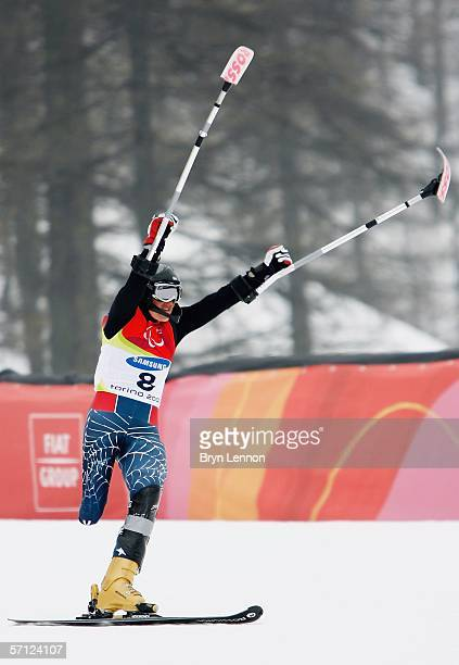 Sandy Dukat of the USA celebrates taking the bronze medal in the Women's Standing Slalom during day eight of the 2006 Paralympic Winter Games on...