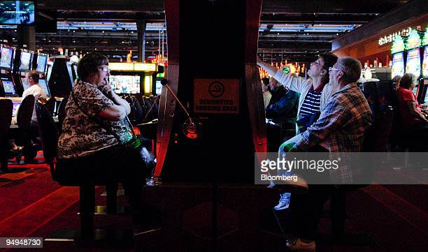 Sandy Frey and Jean Lotti right and Kathy O'Donnell left play slot machines at the Sands Casino Resort Bethlehem in Bethlehem Pennsylvania US on...