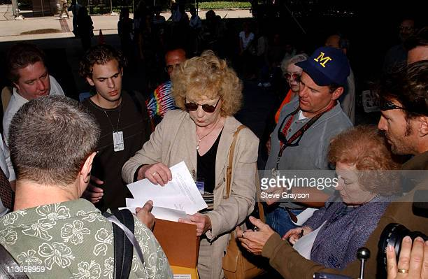 Sandy Gibbons of the Los Angeles District Attorney's office hands out copies of charges filed against actor Robert Blake in the slaying of his wife...
