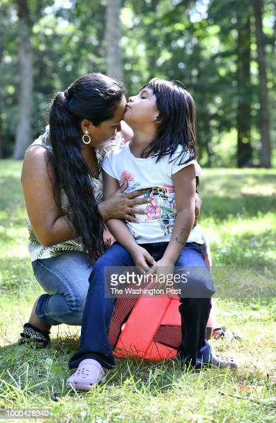 Sandy Gonzalez and her mother Angelica GonzalezGarcia together in the yard at a home in suburban Boston Massachusetts July 11 where the two are now...