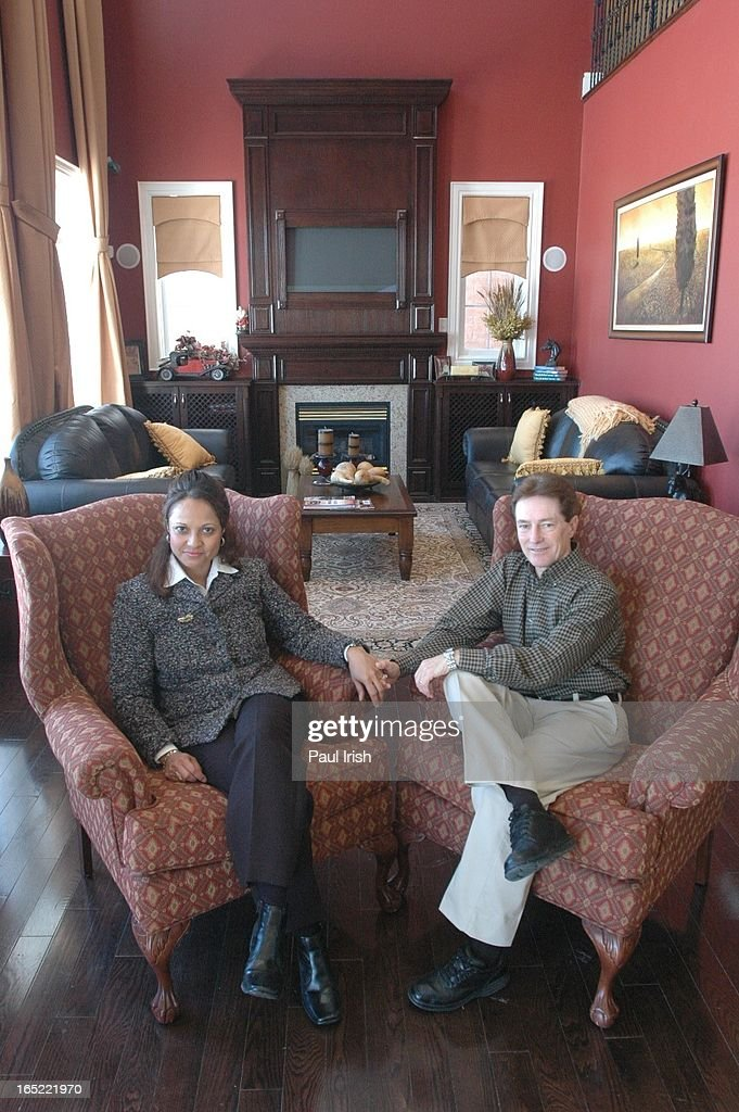 Sandy Hawley with wife, Lisa, sitting in the great room of a model house similar to the one he has b : News Photo