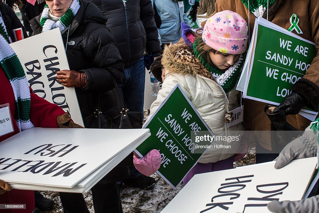 Sandy Hook Elementary School families and supporters gather near the U.S. Capitol for a march for stricter gun control laws on January 26, 2013 in Washington, DC. The demonstrators included survivors of the shooting at Virginia Tech, Newtown, Connecticut, and others.