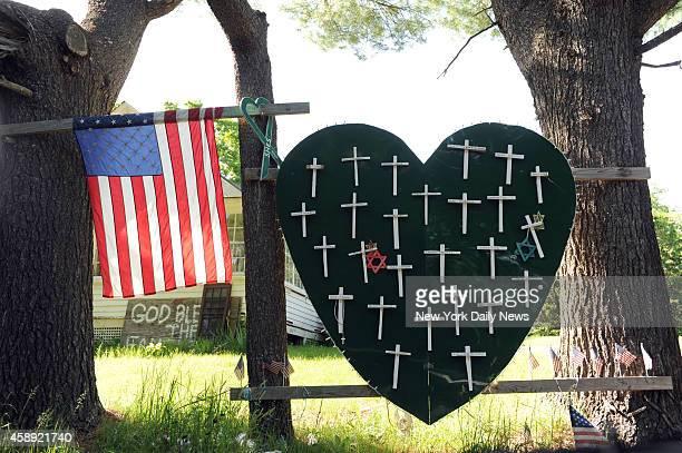 Sandy Hook Elementary School shooting heart and cross memorial near Sandy Hook Firehouse on Riverside Road in Sandy Hook CT