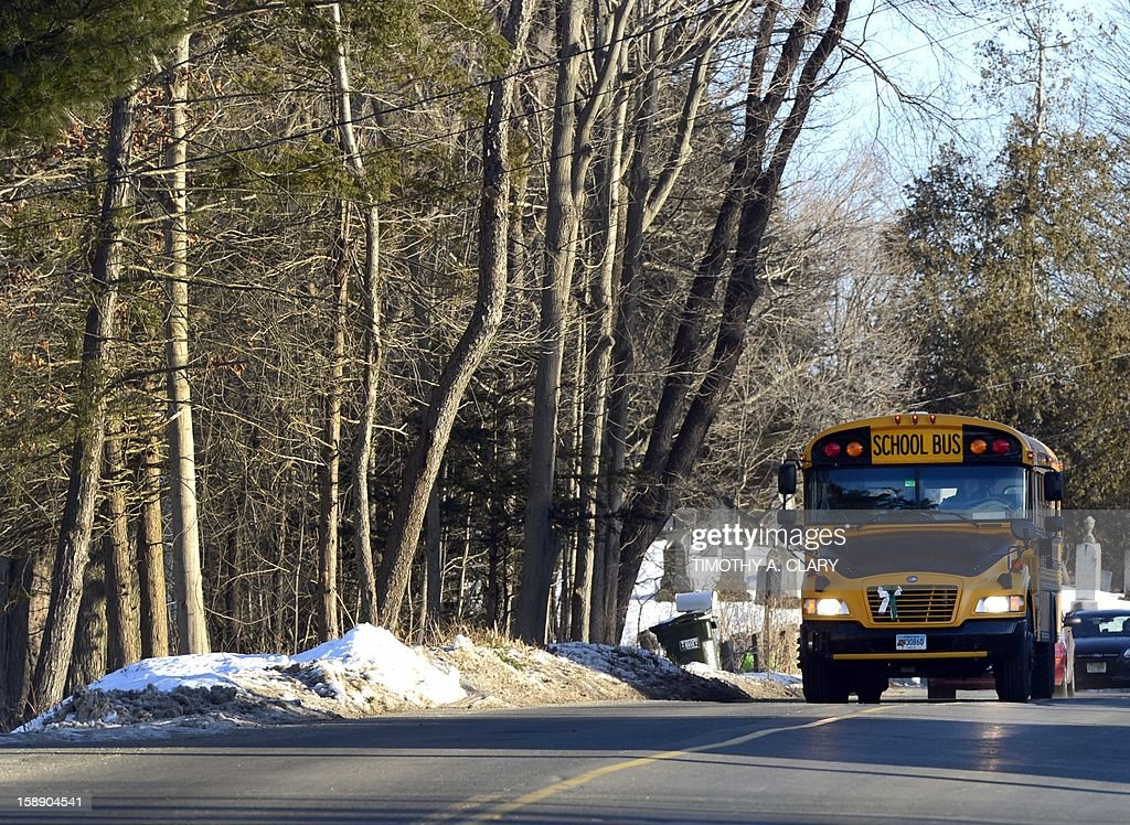 Sandy Hook Elementry students leave on a school bus in Newtown, Connecticut on January 3, 2013. Students at the elementary school where a gunman massacred 26 children and teachers last month were returning Thursday to classes at an alternative campus described by police as 'the safest school in America.' Survivors were finally to start their new academic year in the nearby town of Monroe, where a disused middle school has been converted and renamed from its original Chalk Hill to Sandy Hook.