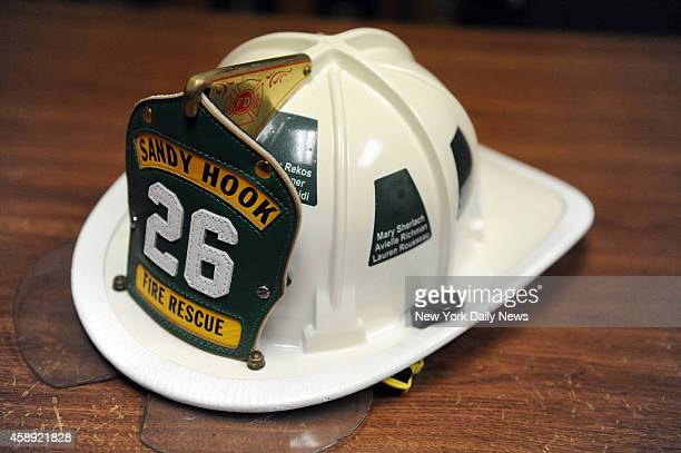 Sandy Hook Memorial Helmet with all the victims names Donated to Sandy Hood Firehouse from Washington CT after the Sandy Hook Elementary School...