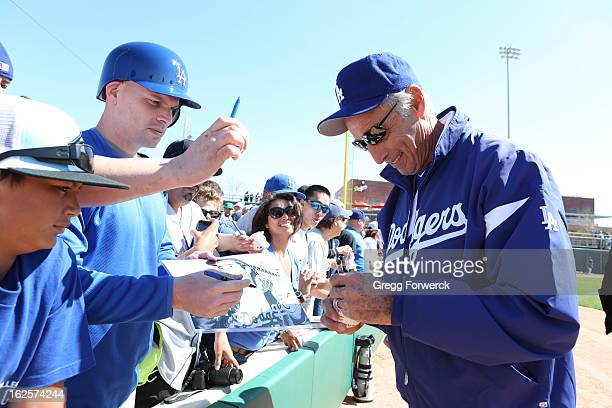 Sandy Kofax of the Los Angeles Dodgers signs autographs for fans prior to a game against the Chicago White Sox during their spring training baseball...