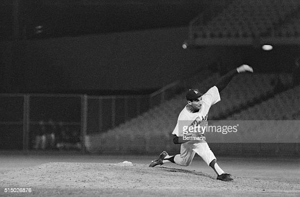 Sandy Koufax checks his cap studies the batter rears back and throws the final pitch 6/30 as he recorded a nohit no run 50 shutout over the New York...