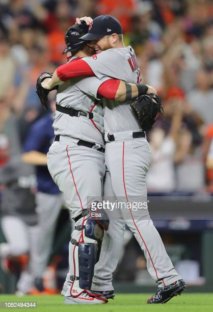 Sandy Leon and Craig Kimbrel of the Boston Red Sox celebrate defeating the Houston Astros 41 in Game Five of the American League Championship Series...