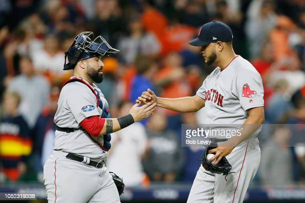 Sandy Leon celebrates with Eduardo Rodriguez of the Boston Red Sox after defeating the Houston Astros 82 in Game Three of the American League...