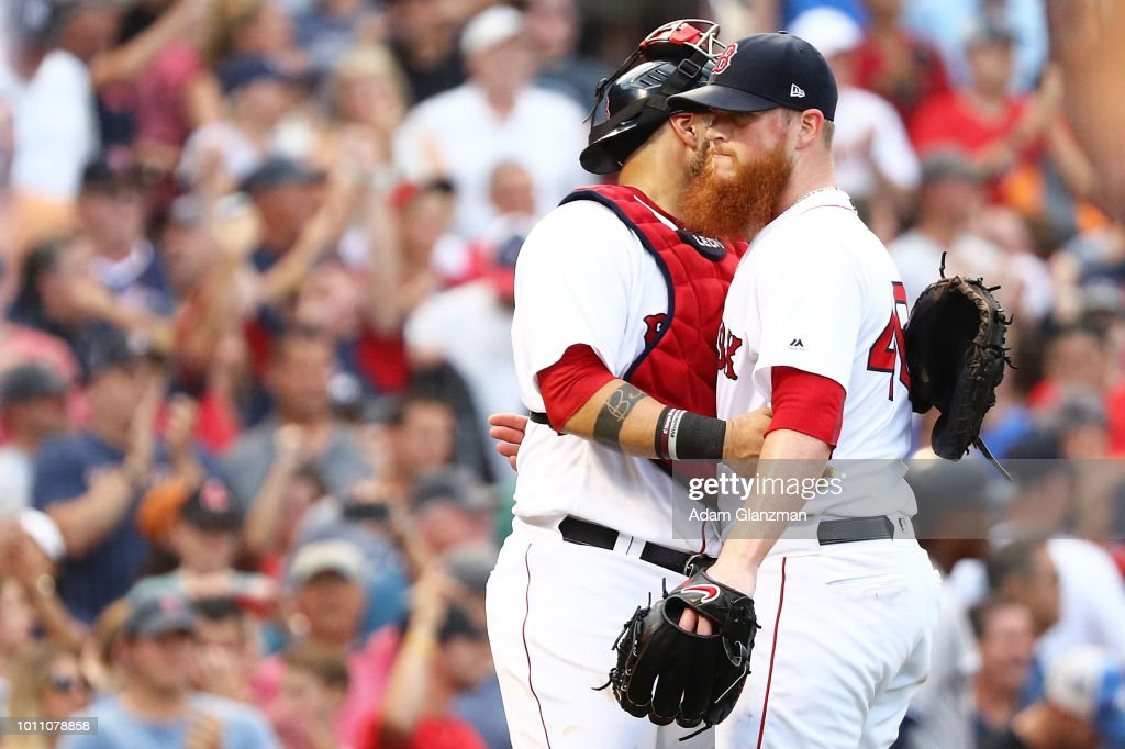 Sandy Leon #3 embraces Craig Kimbrel #46 of the Boston Red Sox after a victory over the Boston Red Sox at Fenway Park on August 4, 2018 in Boston, Massachusetts.