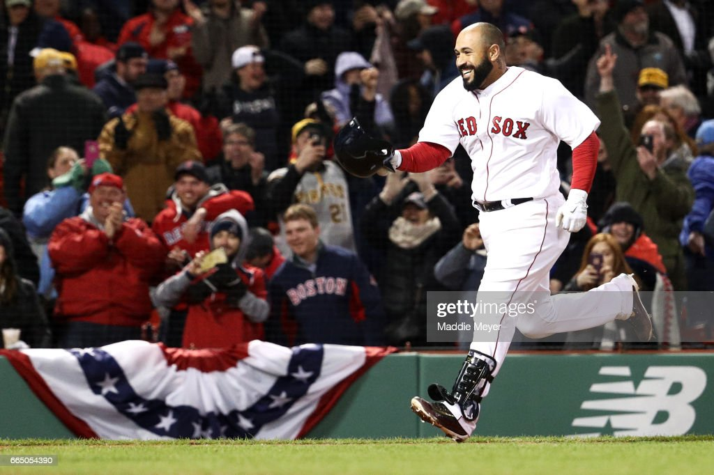 Sandy Leon #3 of the Boston Red Sox celebrates after hitting a three run home run to end the game against the Pittsburgh Pirates during the twelfth inning at Fenway Park on April 5, 2017 in Boston, Massachusetts.