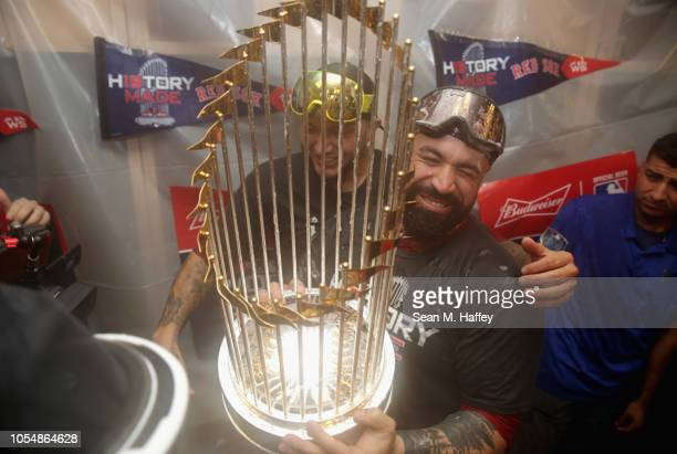 Sandy Leon of the Boston Red Sox celebrates with the world series trophy after his team's 51 win over the Los Angeles Dodgers in Game Five of the...