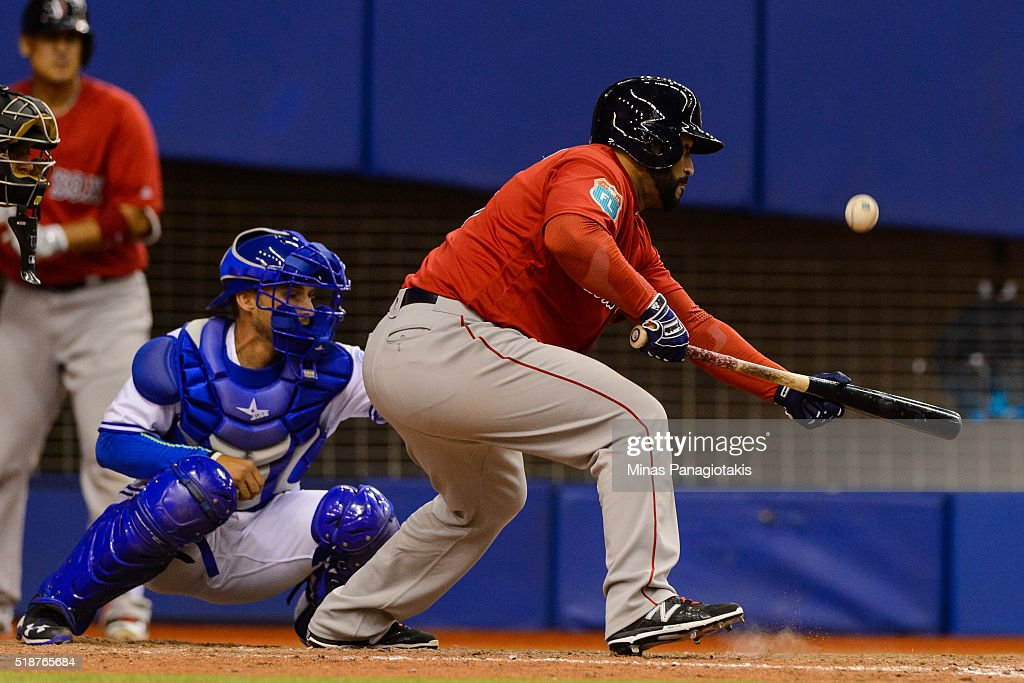 Sandy Leon #3 of the Boston Red Sox hits a sacrifice bunt in the top of the eighth during the MLB spring training game against the Toronto Blue Jays at Olympic Stadium on April 2, 2016 in Montreal, Quebec, Canada. The Boston Red Sox defeated the Toronto Blue Jays 7-4.