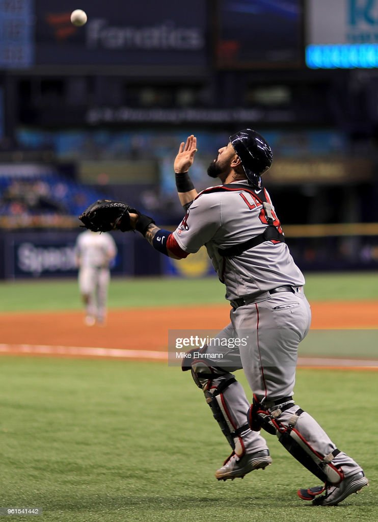 Sandy Leon #3 of the Boston Red Sox makes a catch during a game against the Tampa Bay Rays at Tropicana Field on May 22, 2018 in St Petersburg, Florida.