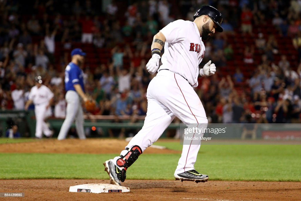 Sandy Leon #3 of the Boston Red Sox rounds the bases after hitting a home run against the Toronto Blue Jays during the eighth inning at Fenway Park on September 26, 2017 in Boston, Massachusetts.