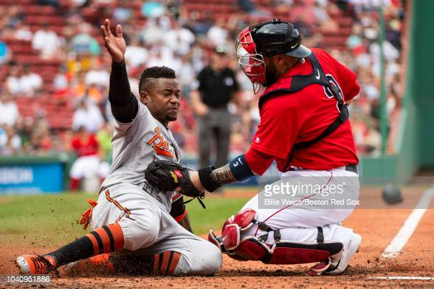Sandy Leon of the Boston Red Sox tags out Tim Beckham of the Baltimore Orioles during the third inning of a game on September 26 2018 at Fenway Park...
