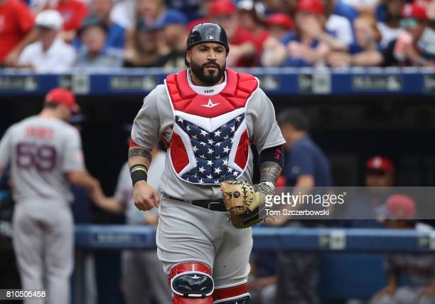 Sandy Leon of the Boston Red Sox wears a stars and stripes design on his chest protector during MLB game action against the Toronto Blue Jays at...