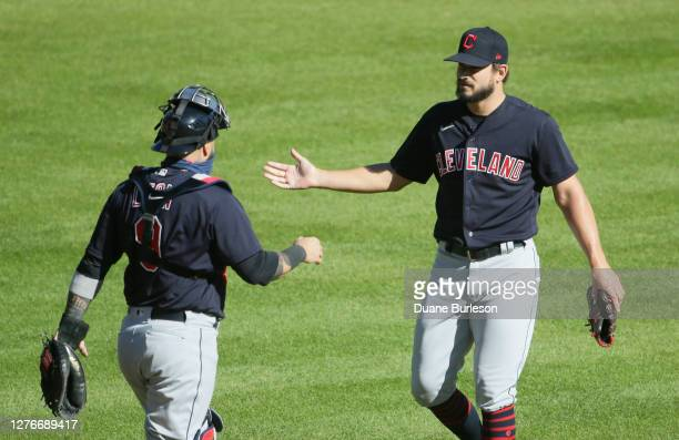 Sandy Leon of the Cleveland Indians and pitcher Brad Hand celebrate a win over the Detroit Tigers at Comerica Park on September 20 in Detroit Michigan