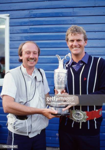 Sandy Lyle of Scotland and sports photographer Phil Sheldon with the Claret Jug and Championship belt following Lyle's victory in the British Open...