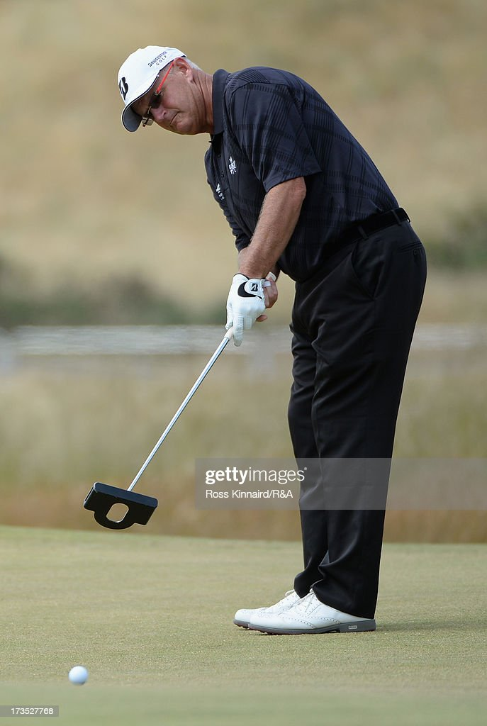 Sandy Lyle of Scotland putts ahead of the 142nd Open Championship at Muirfield on July 16, 2013 in Gullane, Scotland.