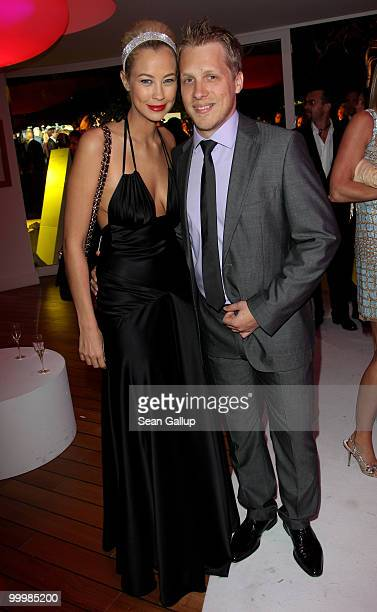 Sandy MeyerWoelden and Oliver Pocher attend the de Grisogono Cocktail Party at the Hotel Du Cap on May 18 2010 in Cap D'Antibes France