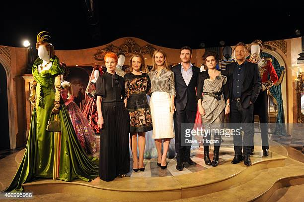 Sandy Powell Holliday Grainger Lily James Richard Madden Helena Bonham Carter and Kenneth Branagh pose during the Cinderella Exhibition Launch...