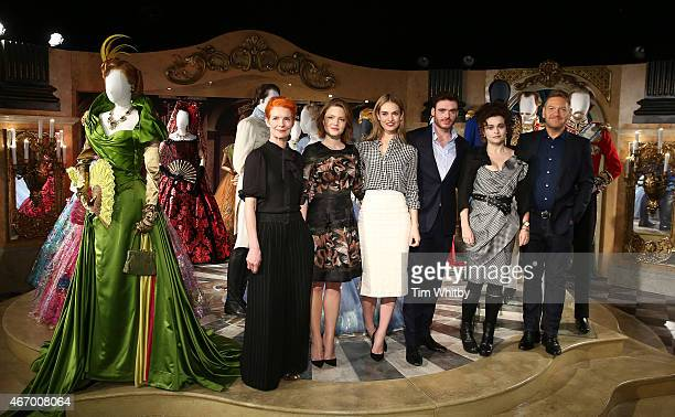 Sandy Powell Holliday Grainger Lily James Richard Madden Helena Bonham Carter and Kenneth Branagh attend a photocall for the Cinderella Exhibition at...