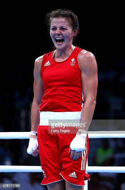 Sandy Ryan of Great Britain celebrates victory over Elena Vystropova of Azerbaijan in the Women's Boxing Light Welterweight Quarter Final during day...