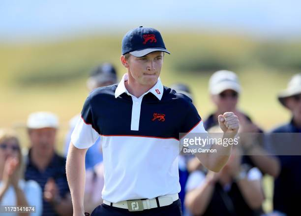 Sandy Scott of the Great Britain and Ireland team celebrates a birdie to win the first hole in his match against Brandon Wu of the United States...