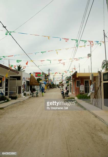 sandy street on holbox island mexico that is decorated with small flags - holbox island fotografías e imágenes de stock