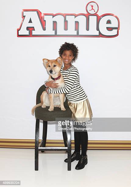 Sandy the Dog and Quvenzhane Wallis attend 'Annie' Cast Photo Call at Crosby Street Hotel on December 4 2014 in New York City