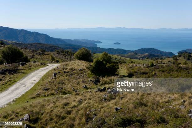 Sandy track in the Abel Tasman National Park with a view of Marlborough Sounds, Tasmania, South Island, New Zealand
