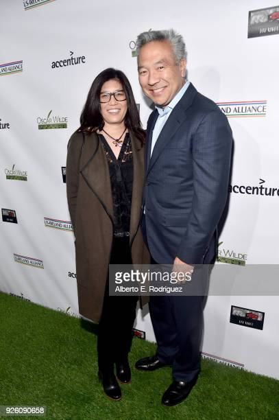 Sandy Tsujihara and Warner Bros Entertainment CEO Kevin Tsujihara attend the Oscar Wilde Awards 2018 at Bad Robot on March 1 2018 in Santa Monica...