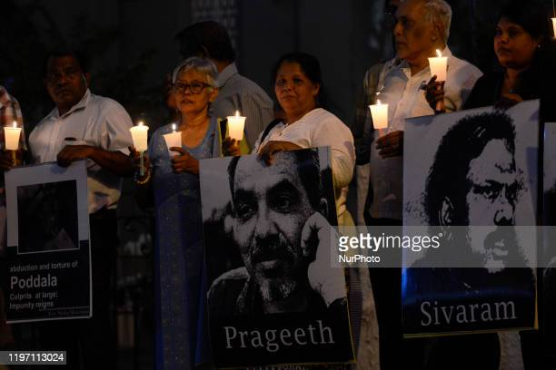 Sandya Eknelygoda , wife of a victim of enforced disappearance journalist Prageeth Ekneligoda is seen among a crowd of demonstrators, holding a...