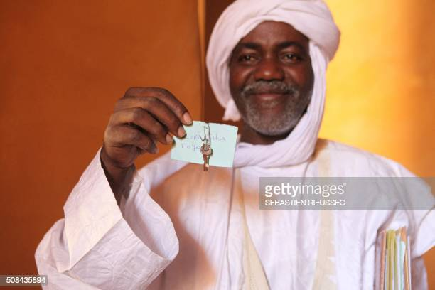 Sane Chirfi representing the family which looks after the mausoleum of Alpha Moya poses with the key of the mausoleum on February 4 2016 Timbuktu...