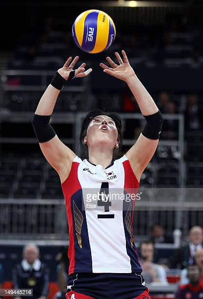 SaNee Kim of Korea sets the ball in the second set against United States during Women's Volleyball on Day 1 of the London 2012 Olympic Games at Earls...