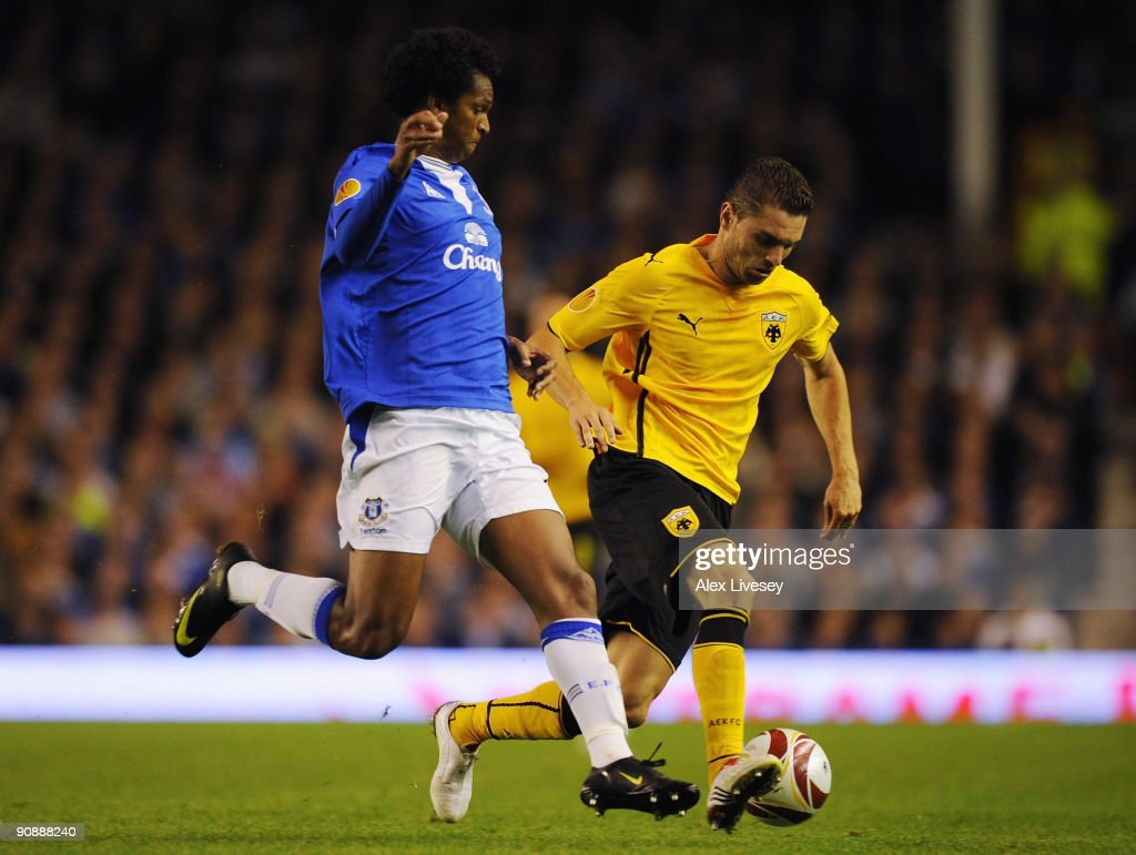 Sanel Jahic of AEK Athens holds off a challenge from Jo of Everton during the UEFA Europa League Group I match between Everton and AEK Athens at Goodison Park on September 17, 2009 in Liverpool, England.