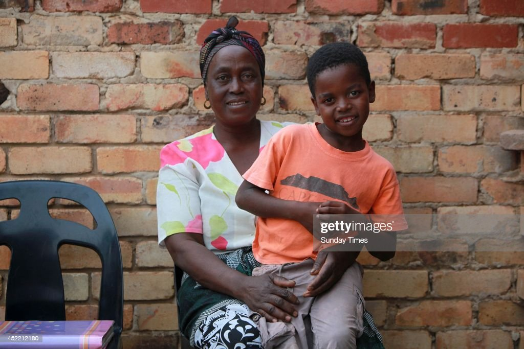 Sanele Masilela, a nine year-old with his wife Helen Shabangu, 62 year-old on July 14, 2014 in Bushbuckridge, South Africa. Sanele who married Helen last year in a bid to appease his ancestors, repeated the ceremony this year. The wedding was arranged after Sanele was tormented by his late grandfather, Busy Masilela and other ancestral spirits. Sanele's mother explained to guests that Busy had never been married and he wanted his grandson to do so to appease the spirits.