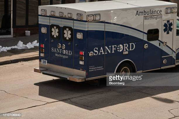 A Sanford Health ambulance drives in front of the USD Medical Center in Sioux Falls South Dakota US on Wednesday April 15 2020 South Dakota Governor...